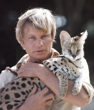 Michael York in The Island of Dr Moreau with serval cat